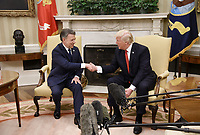 United States President Donald J. Trump shakes hands with President Juan Manuel Santos of Colombia during a meeting in the Oval Office of  the White House, on May 18, 2017 in Washington, DC. <br /> Credit: Olivier Douliery / Pool via CNP/MediaPunch