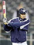 Seattle Mariners'  Ichiro Suzuki swings a warm-up bat before  their major league opener against the Minnesota Twins in Seattle, Washington on Monday, 04 April, 2005. Jim Bryant Photo. ©2010. ALL RIGHTS RESERVED.