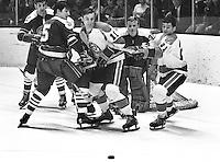 Seals vs Pittsburg Penguins, #11 Nick Harbaruk, and #21 Michael Briere, Seals Carol Vadnais, and goalie Gary Smith. (1970 photo/Ron Riesterer)