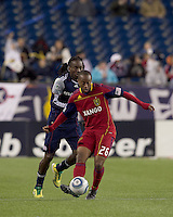 Real Salt Lake midfielder Collen Warner (26) passes the ball as New England Revolution midfielder Shalrie Joseph (21) closes. In a Major League Soccer (MLS) match, Real Salt Lake defeated the New England Revolution, 2-0, at Gillette Stadium on April 9, 2011.