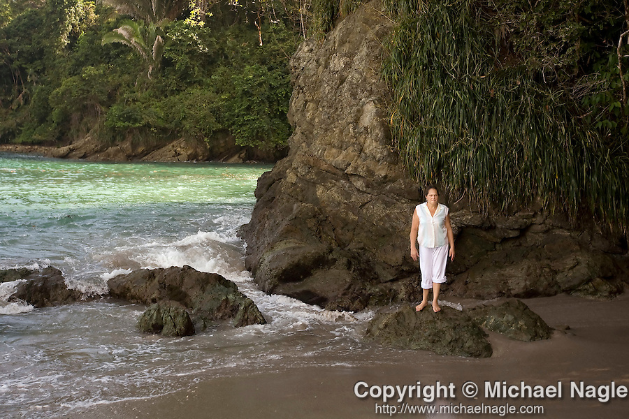 MANUEL ANTONIO, COSTA RICA- JANUARY 11, 2009:  A woman stands on a rock at Manuel Antonio Beach inside Manuel Antonio National Park on January 11, 2009 in Manuel Antonio, Costa Rica.    (Photo by Michael Nagle)