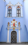 Saint Michael's sky-blue beautiful christian cathedral door with a Saint Catherine icon above Kiev Ukraine Eastern Europe Vertical orientation