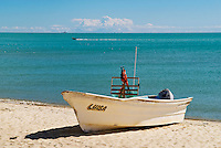 Fishing boat sits on sandy beach at Sea of Cortez, San Felipe, Baja California, Mexico