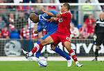 St Johnstone v Aberdeen...21.08.10  .Josh Magennis battles with Michael Duberry.Picture by Graeme Hart..Copyright Perthshire Picture Agency.Tel: 01738 623350  Mobile: 07990 594431
