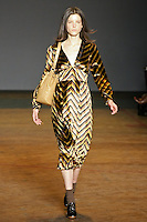 Tati Cotliar walks runway in an outfit from the Marc by Marc Jacobs Fall/Winter 2011 collection, during New York Fashion Week, Fall 2011.