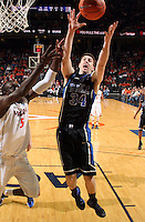 Feb. 16, 2011; Charlottesville, VA, USA; Duke Blue Devils forward Ryan Kelly (34) grabs the rebound next to Virginia Cavaliers center Assane Sene (5) during the second half of the game at the John Paul Jones Arena. The Duke Blue Devils won 56-41.  Credit Image: © Andrew Shurtleff