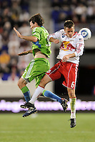 Brad Evans (3) of the Seattle Sounders and Seth Stammler (6) of the New York Red Bulls go up for a header. The Seattle Sounders defeated the New York Red Bulls 1-0 during a Major League Soccer (MLS) match at Red Bull Arena in Harrison, NJ, on May 15, 2010.