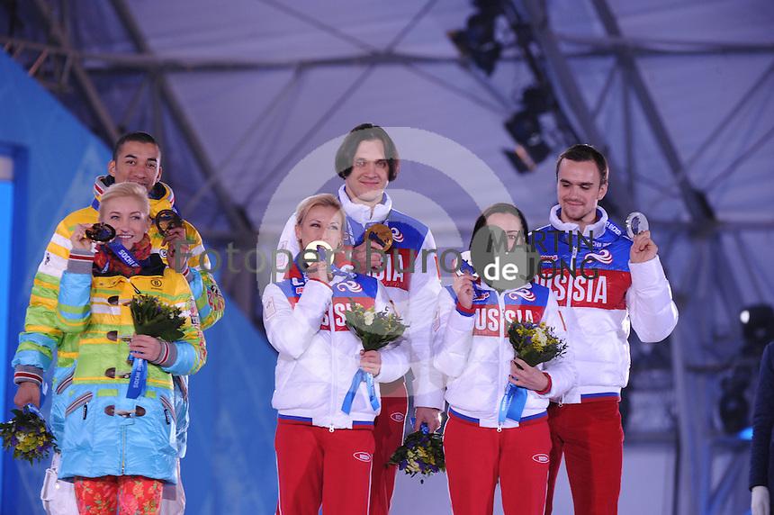 OLYMPICS: SOCHI: Medal Plaza, 13-02-2014, Figure Skating, Pairs, Aliona Savchenko and Robin Szolkowy (GER), Tatiana Volosozhar and Maxim Trankov (RUS), Ksenia Stolbova and Fedor Klimov (RUS), ©photo Martin de Jong