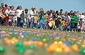 Joe Imel/Daily News.Participants get ready to hunt Saturday at the Mega Easter Egg Hunt sponsored by Bowling Green First Assembly  of God. Thousands of children and their parents hunted for 50,000 candy-filled eggs at the Bowling Green/Warren County Regional Airport.