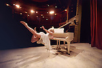 A conceptual image of a woman flying and playing the piano