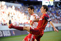 Will Johnson (8) of Real Salt Lake plays the ball away from Rafael Marquez (4) of the New York Red Bulls during a Major League Soccer (MLS) match at Red Bull Arena in Harrison, NJ, on October 09, 2010.