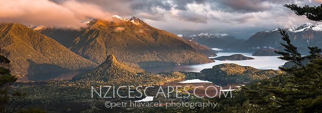 Sunrise over Hope Arm of Lake Manapouri with Monument on left, Fiordland National Park, Southland, UNESCO World Heritage Area, New Zealand, NZ