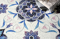 Aurelia, a handmade mosaic shown in Absolute White, Rhodolite, Amethyst, Rose Quartz, Pearl, and Blue Spinel Sea Glass&trade; is part of the Sea Glass&trade; Collection by Sara Baldwin for New Ravenna. <br />