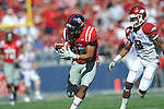 Ole Miss' Donte Moncrief (12) bobbles a pass as Arkansas cornerback Tevin Mitchel (8) defends at Vaught-Hemingway Stadium in Oxford, Miss. on Saturday, October 22, 2011. .