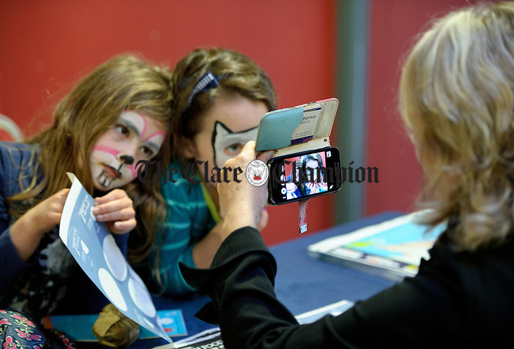 Jaia Hughes and Roisin O Dwyer are caught on camera during the Burren Food Fayre in the Pavilion, Lisdoonvarna as part of the Burren Winterage Weekend. Photograph by John Kelly.