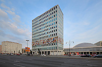 Haus des Lehrers or House of the Teachers, built 1962-64 in East Germany or the GDR, with a mosaic mural by Walter Womacka entitled Unser Leben or Our Life, Berlin, Germany. To the right is the Berliner Congress Centre. Picture by Manuel Cohen