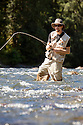 WA09135-00...WASHINGTON - Fly fishing on the Middle Fork of the Snoqualme River near North Bend. (MR# J9)