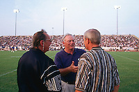 AUSTIN, TX - Owner Al Davis of the Oakland Raiders (left) talks with Dallas Cowboys owner Jerry Jones (center) and someone else during training camp with the Dallas Cowboys in Austin, Texas in 1997. Photo by Brad Mangin
