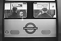 London, UK. 16.01.2016. Passengers in a tube carriage, viewed from outside.  Photograph © Jane Hobson.
