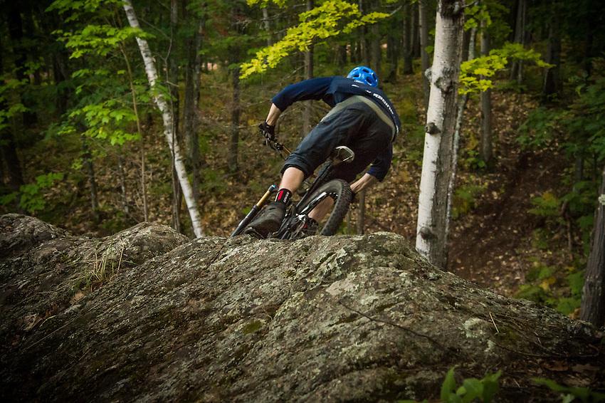 Mountain biking the Dobbs Trail at Harlow Lake area near Marquette, Michigan.