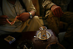 Marine Lt. Col. Craig Kozeniesky - battalion commander for 2nd Battalion 5th Marines (2/5) - meets with Sheik Khattab in central Ramadi to discuss the future over a glasses of traditional Iraqi 'chai' tea in central Ramadi on Tuesday May 10, 2007. In recent weeks and months, Ramadi, the provincial capital of the turbulent al-Anbar province has turned from one of the most deadly places in Iraq into an island of relative stability as tribal leaders there have split from the insurgency after years of killings and intimidation.