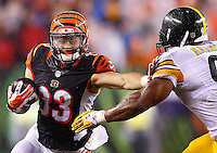 Rex Burkhead #33 of the Cincinnati Bengals attempts to evade a tackle by James Harrison #92 of the Pittsburgh Steelers during the Wild Card playoff game at Paul Brown Stadium on January 9, 2016 in Cincinnati, Ohio. (Photo by Jared Wickerham/DKPittsburghSports)