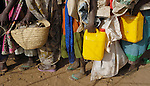 Lining up for water in a displaced persons camp in Darfur. Since 2003, more than 2.5 million people have been displaced by attacks on African farming villages by government-aligned Arab militias.
