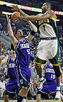 Seattle Supersonics' Rashard Lewis, R, battles with Sacramento Kings' Brad Miller , L, for a rebound in the second period of their Western Conference First Round Game #2 at Key Arena in Seattle, Washington Thursday, 21 April  2005..Jim Bryant Photo. &copy;2010. All Rights Reserved.