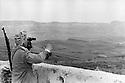 Iraq 1974 <br /> The resumption of hostilities,near Koysanjak, a peshmerga with binoculars looking at an Iraqi military camp  <br /> Irak 1974 <br /> La reprise de la lutte arm&eacute;e, pres de Koysanjak, un peshmerga surveillant avec des jumelles un camp militaire irakien