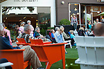 Spectators gather on the State Street Green for a performance by The Terrible Adult Chamber Orchestra August 2.