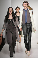 Senior fashion designer Gianna Lucci, walks runway with model, at the close of the Pratt 2011 fashion show.