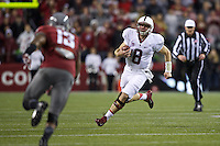 Stanford quarterback Kevin Hogan scrambles during play against Washington State at CenturyLink Field in Seattle Saturday September 28, 2013.