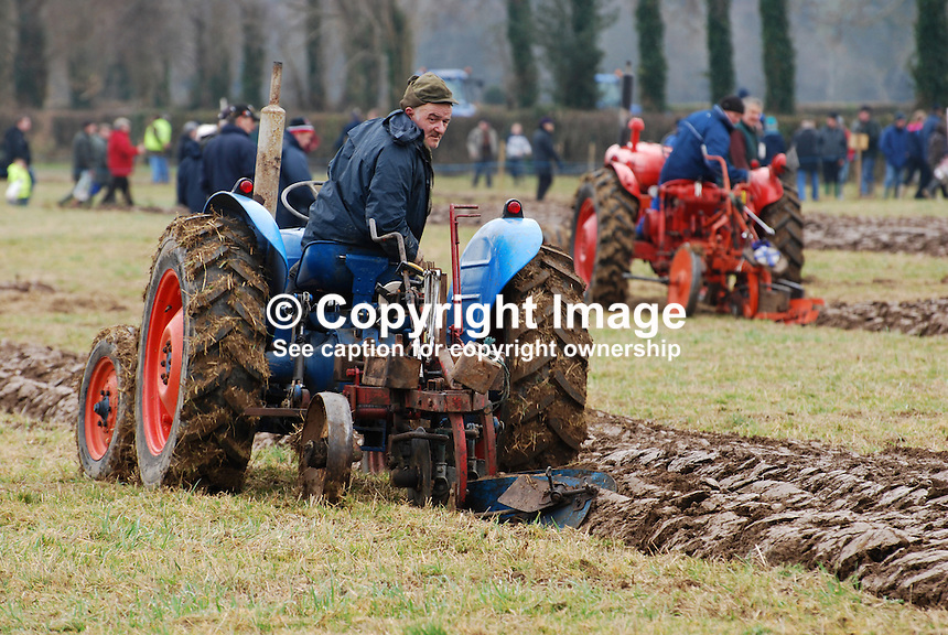 A competitor taking part in the tractor class. Taken 28 February 2009 at 95th annual ploughing match of Mullahead & District Ploughing Society, Co Down, N Ireland, UK, Ploughing_200902281964..Copyright Image from Victor Patterson, 54 Dorchester Park, Belfast, UK, BT9 6RJ..Tel: +44 28 9066 1296.Mob: +44 7802 353836.Voicemail +44 20 8816 7153.Skype: victorpattersonbelfast.Email: victorpatterson@mac.com.Email: victorpatterson@ireland.com (back-up)..IMPORTANT: If you wish to use this image or any other of my images please go to www.victorpatterson.com and click on the Terms & Conditions. Then contact me by email or phone with the reference number(s) of the image(s) concerned.