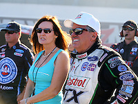 Sep 14, 2013; Charlotte, NC, USA; NHRA funny car driver John Force (right) with wife Laurie Force during qualifying for the Carolina Nationals at zMax Dragway. Mandatory Credit: Mark J. Rebilas-