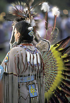 Native American at pow wow wearing regalia hand made for dance contests
