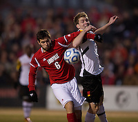 Jereme Raley (12) of Maryland fights for the ball with Dylan Mares (6) of Louisville during the game at Ludwig Field in College Park, MD.  Maryland defeated Louisville, 3-1.