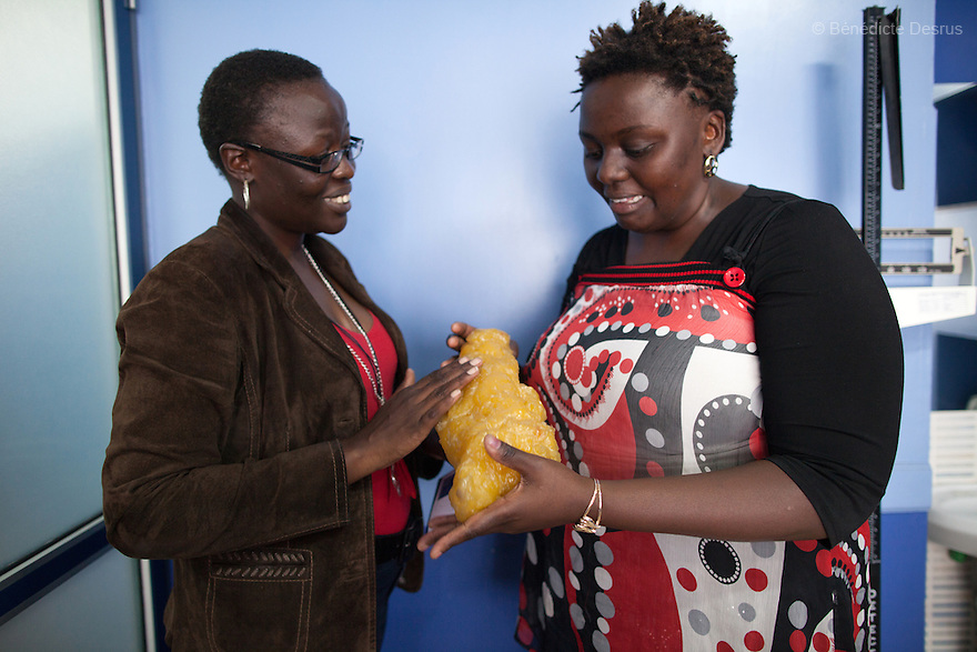 """AliceOjwang-Ndong, a Kenyan nutritionist and dietetic consultant, shows a model of fatty tissueto Ruth during a weightloss management program in Nairobi, Kenyaon December 17, 2012. Ruth Gathu is a 35 year-old Kenyan woman who works as an office administrator. She weighs 299 pounds and weighs 175 centimeters, with a BMI of 44.3. She says: """"In Kenya, people don't spend money on nutrition programs""""…""""Obesity is in all the social class in Kenya, the rich, the middle class and the poor."""" Nairobi has a high prevalence of overweight and obesity among women, especially those in the middle and upper class. Like elsewhere in the world, the main drivers of obesity in Kenya are rapid urbanization and westernization, that have resulted in changing lifestyles such as increased consumption of """"unhealthy diets"""" and adoption of sedentary lifestyles. Photo by Bénédicte Desrus"""