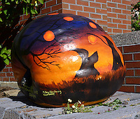 Painted pumpkin on display by artist outside library in Damariscotta Maine