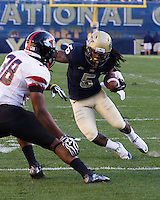 Pitt wide receiver Cam Saddler tries to avoid Gardner-Webb linebacker Chad Geter (38) after making a catch. The Pitt Panthers defeated the Gardner-Webb Runnin Bulldogs 55-10 at Heinz Field, Pittsburgh PA on September 22, 2012..