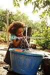 Girl at new water tap, Pico Bonito, Honduras