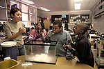 Berkeley CA Young teacher helping 3rd graders with dry ice experiment in class