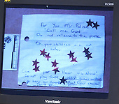 A note found near the shooting scene of Conrad Johnson on October 23, 2002 in Aspen Hill, Maryland, is displayed on a screen duiring the trial of sniper suspect John Allen Muhammad in courtroom 10 at the Virginia Beach Circuit Court in Virginia Beach, Virginia on November 3, 2003.<br /> Credit: Lawrence Jackson - Pool via CNP