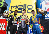 Jun 6, 2016; Epping , NH, USA; NHRA top fuel driver Antron Brown (left) celebrates with pro stock driver Greg Anderson (center) and funny car driver Ron Capps after winning the New England Nationals at New England Dragway. Mandatory Credit: Mark J. Rebilas-USA TODAY Sports
