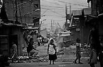 A young Muslim girl walks through the trash strewn streets in the Manila slum Baseco on Jan. 23, 2007. Manila has undergrown rapid growth in recent decades as the rural poor have migrated to the city to escape violence and poverty in the provinces.