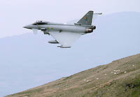 A Typhoon pass low at Bwlch. The 'Mach Loop' is the nick name of an area in Wales used for low flying by the Royal Air Force. The proximity to the aircraft has made the area popular with plane spotters who come to see and photograph the aircraft.