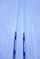 Cross-country skis go down a hill at Blueberry Ridge ski area near Marquette, Michigan.