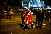 IRAQ, SULAIMANIYAH:  A revelers dressed as Baba Noel (Santa Claus or Father Christmas) walked down Salim street with his friends in Sulaimaniyah...Revelers brought in the new year all across Kurdistan with shows of fireworks and enormous street parties...Photo by Metrography