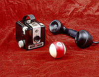 BAKELITE ITEMS: PHONE, BILLIARD BALL, CAMERA<br /> The First Synthetic Polymer<br /> Formed by the reaction of phenol &amp; formaldehyde. Discovered in 1907 by Leo H. Bakeland. When molded under high pressure &amp; temperature it cannot be softened again or dissolved. Spawned the plastics industry.