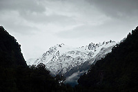 Snow covered mountains above Franz Josef glacier, New Zealand