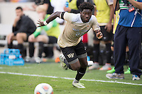 Houston, TX -  Sunday, December 11, 2016: Ema Twumasi (22) of the Wake Forest Demon Deacons brings the ball up the field in the 2h/ against the Stanford Cardinal  at the  NCAA Men's Soccer Finals at BBVA Compass Stadium.